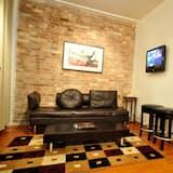 Suite Deluxe, con acceso para silla de ruedas, bañera - Sala de estar