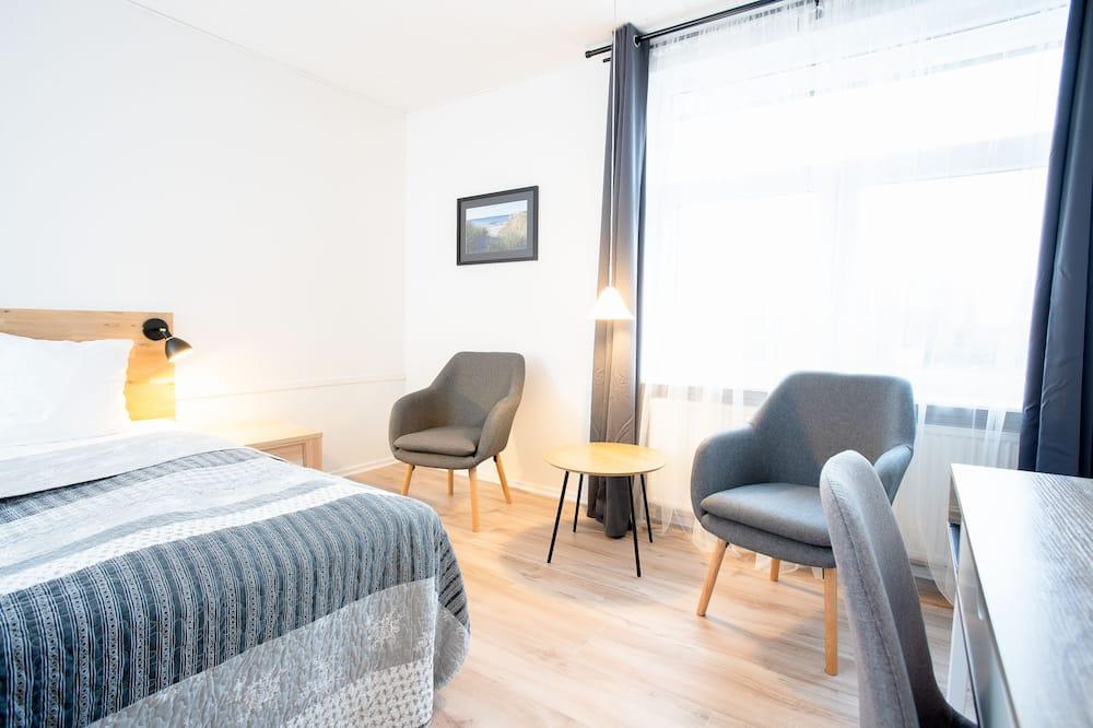 Habitación Confort con 2 camas individuales - Zona de estar