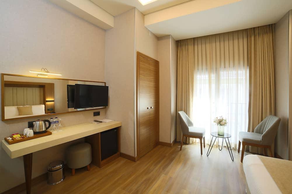 Habitación cuádruple familiar - Zona de estar