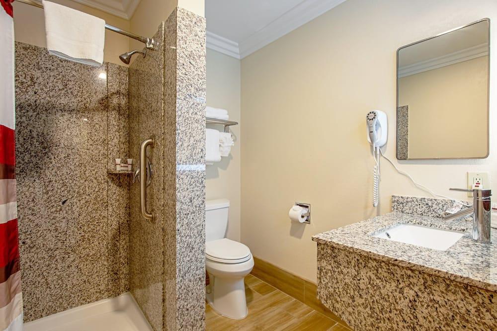 Suite, plusieurs lits, non-fumeurs, baignoire à jets - Salle de bain