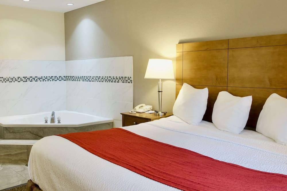 套房, 1 張特大雙人床, 非吸煙房, 按摩浴缸 - 客房
