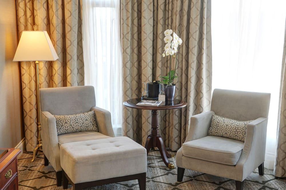 Deluxe Corner Room - Living Area