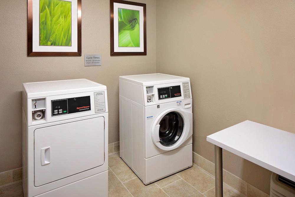 Máquina de lavar e/ou secar no quarto