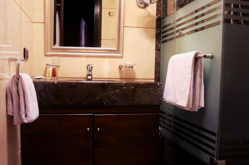 ห้องจูเนียร์สวีท, 1 ห้องนอน, วิวเมือง - ห้องน้ำ