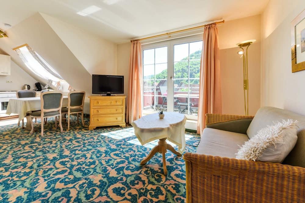 Appartement Supérieur, 1 chambre, vue montagne, côté cour intérieure - Coin séjour