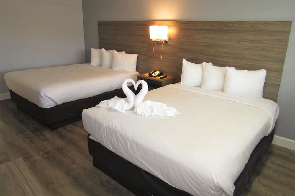 غرفة عادية - سريران كبيران - تجهيزات لذوي الاحتياجات الخاصة - غرفة نزلاء