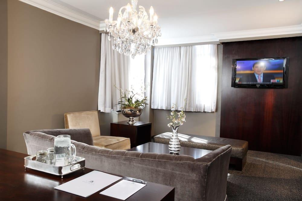 Люкс, Несколько кроватей - Зона гостиной