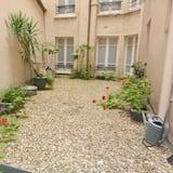 Habitación con 2 camas individuales - Vista al patio