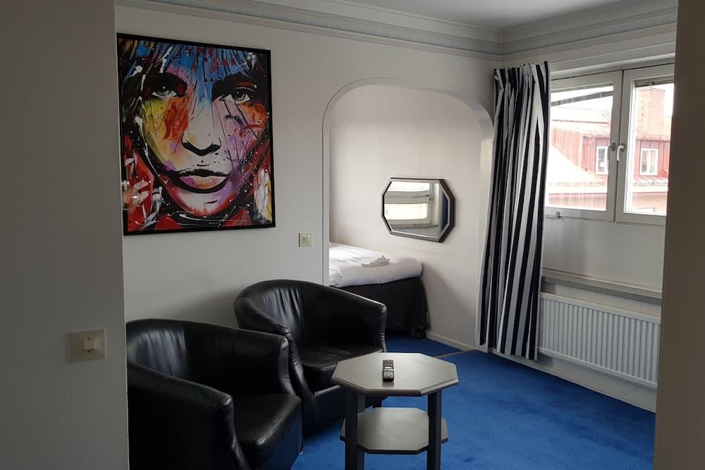 Family Triple Room - Living Area