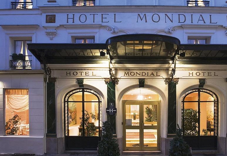 Hôtel Mondial, Paris, Hotelfassade am Abend/bei Nacht