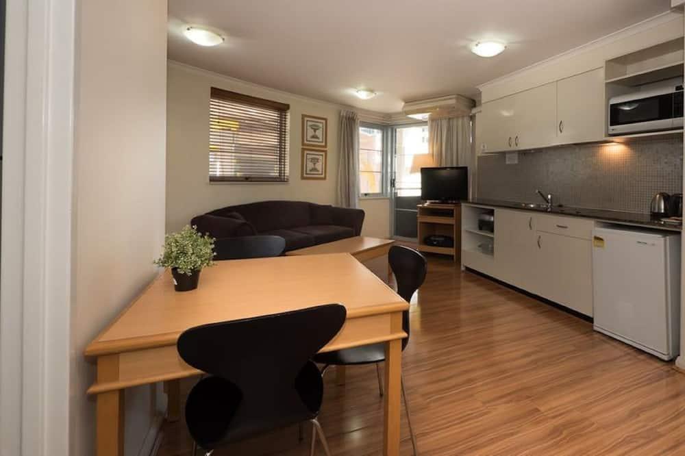 Standaard appartement, 1 slaapkamer - Eetruimte in kamer