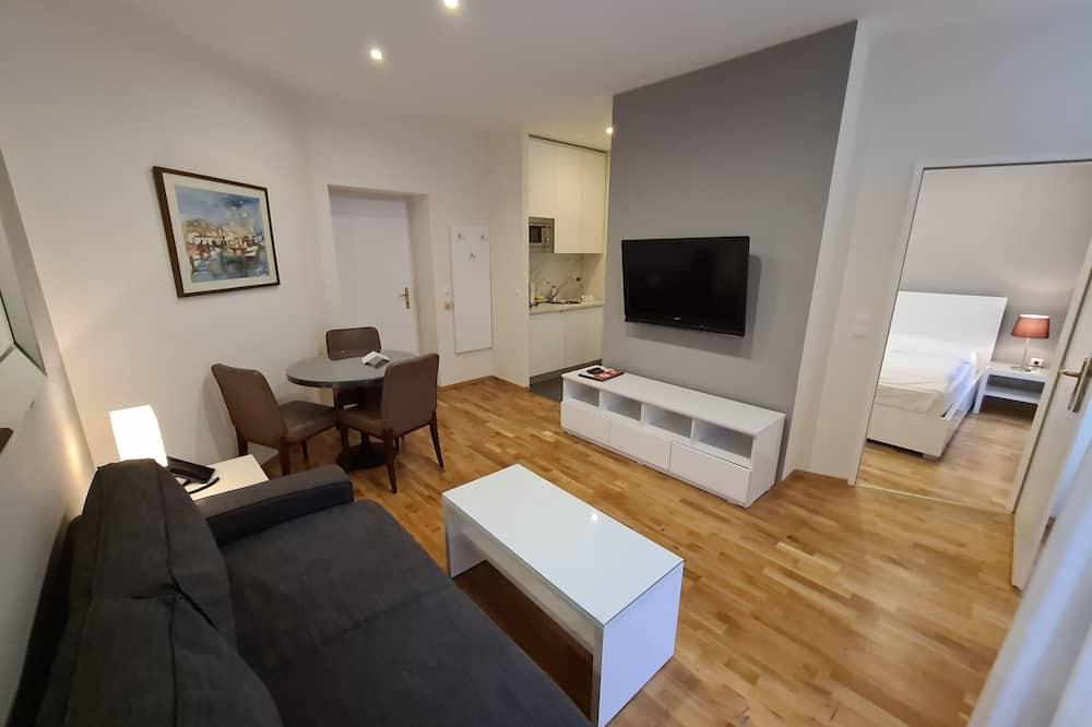 Apartamento conforto - Área de estar