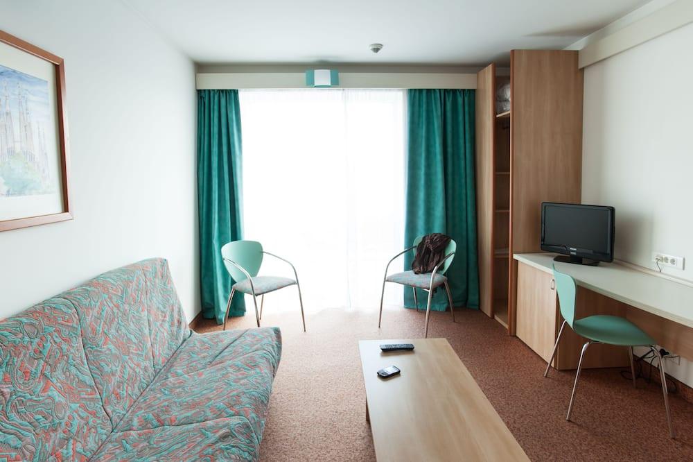 Komforta luksusa numurs, 1 divguļamā karalienes gulta - Dzīvojamā istaba