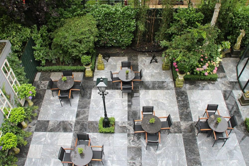 Habitación estándar, 1 cama doble o 2 camas individuales - Vista al jardín