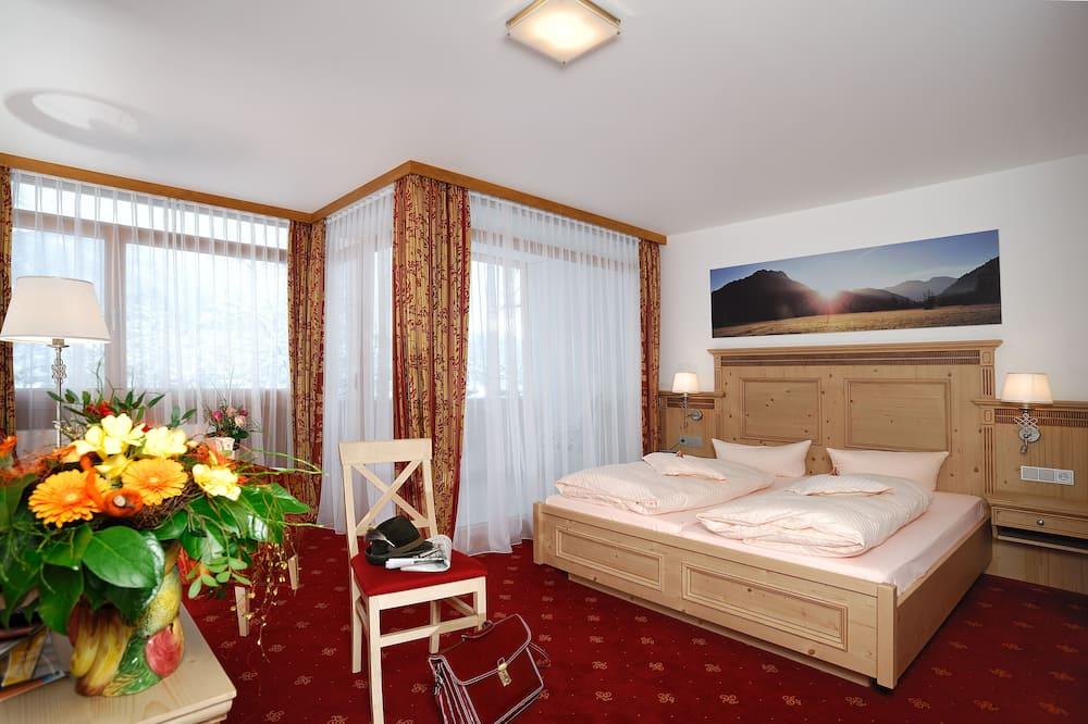 Dvojlôžková izba typu Superior - Obývačka