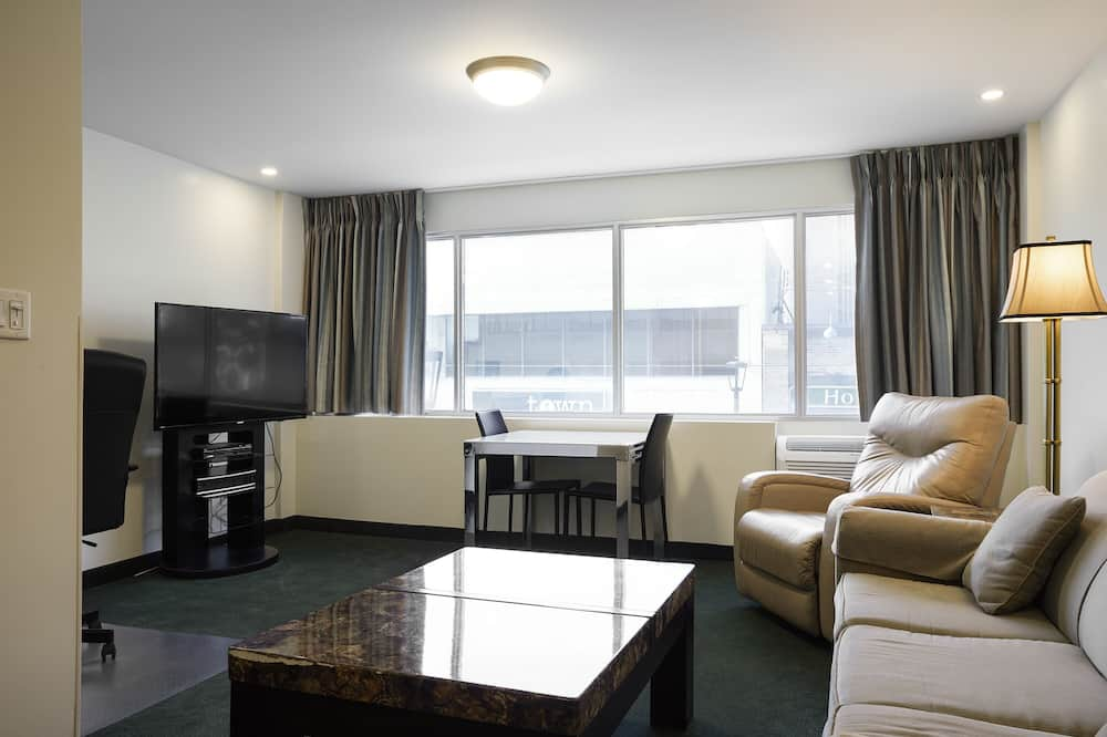 Suite ejecutiva, 1 cama King size con sofá cama - Sala de estar
