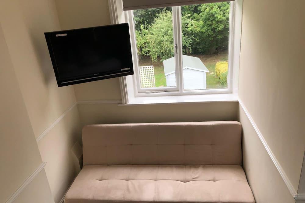 Tweepersoonskamer, uitzicht op tuin - Extra bedden