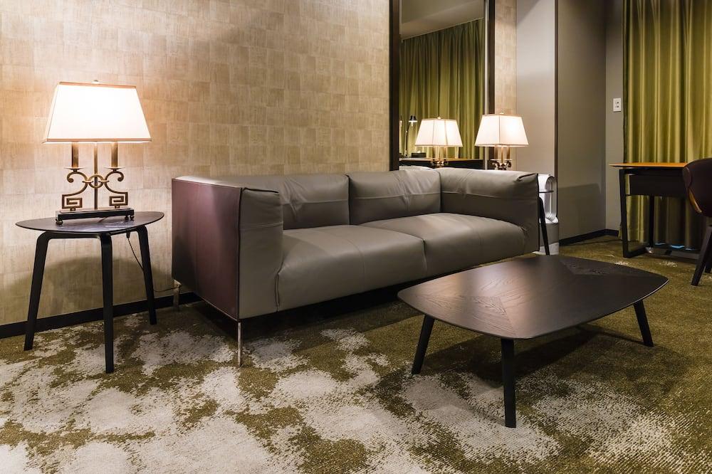 Suite Junior, 1 très grand lit (Poltrona Frau) - Coin séjour