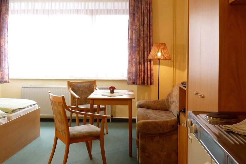 Habitación triple - Sala de estar