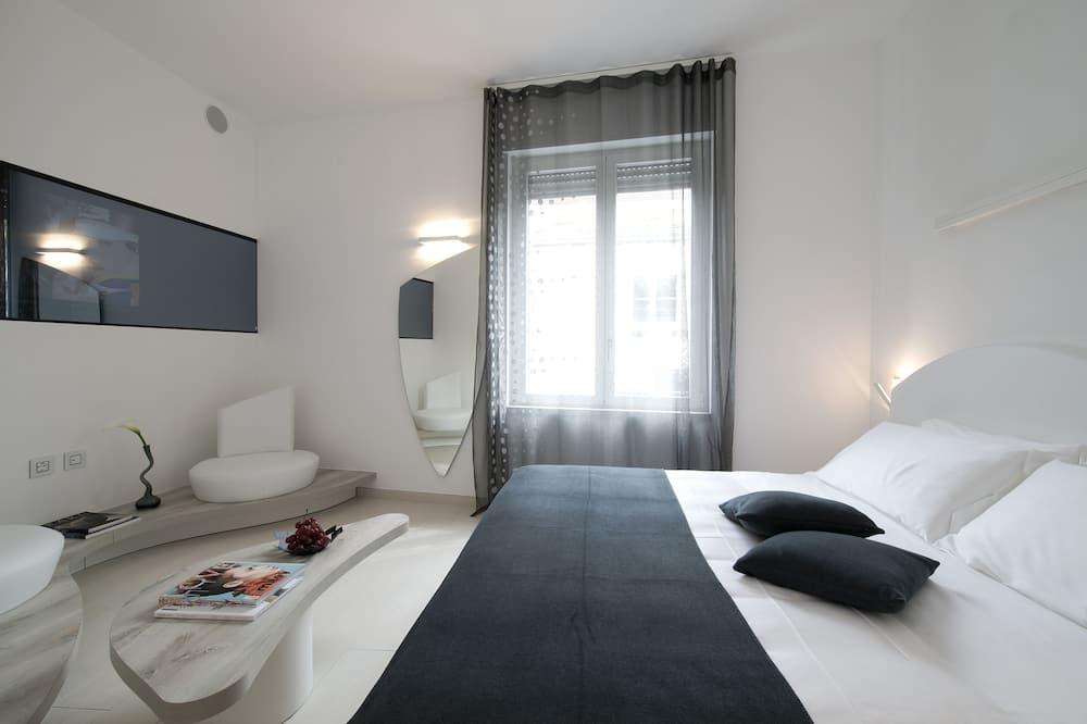 Liukso klasės apartamentai - Vaizdas iš svečių kambario