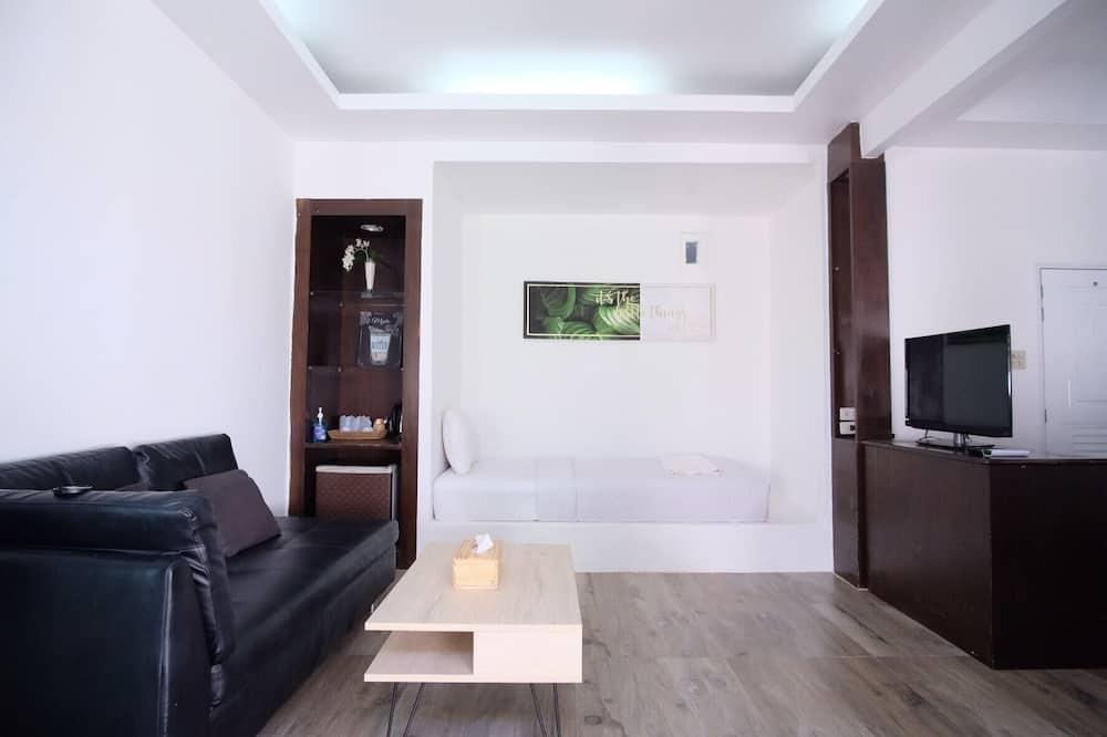 Chambre Triple Supérieure - Salle de séjour