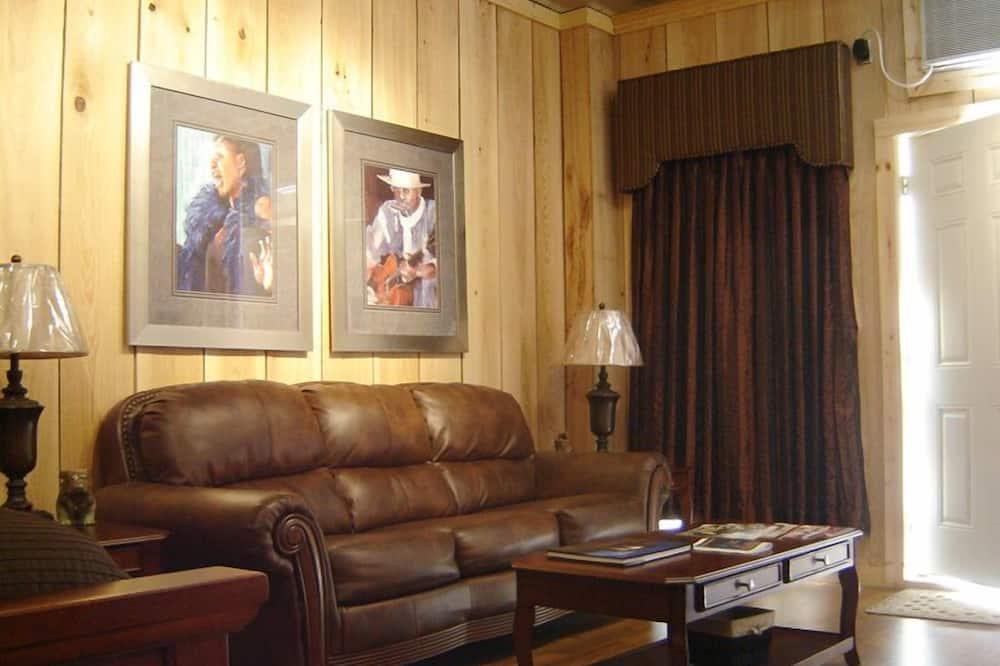 Klasisks studijas tipa luksusa numurs, 1 divguļamā karalienes gulta un dīvāngulta - Dzīvojamā zona