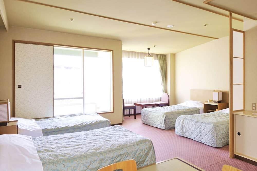 Superior Quadruple Room, Non Smoking - Living Area