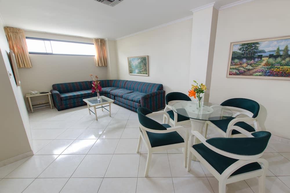 Departamento Premium, 2 habitaciones, baño privado, vista a la ciudad - Sala de estar