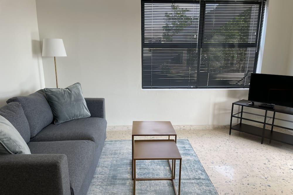 Deluxe suite, 1 king size krevet i kauč na rasklapanje, kuhinja, pogled na ocean - Dnevni boravak