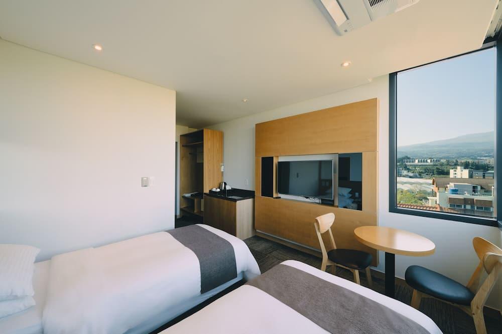 Habitación Business triple - Zona de estar
