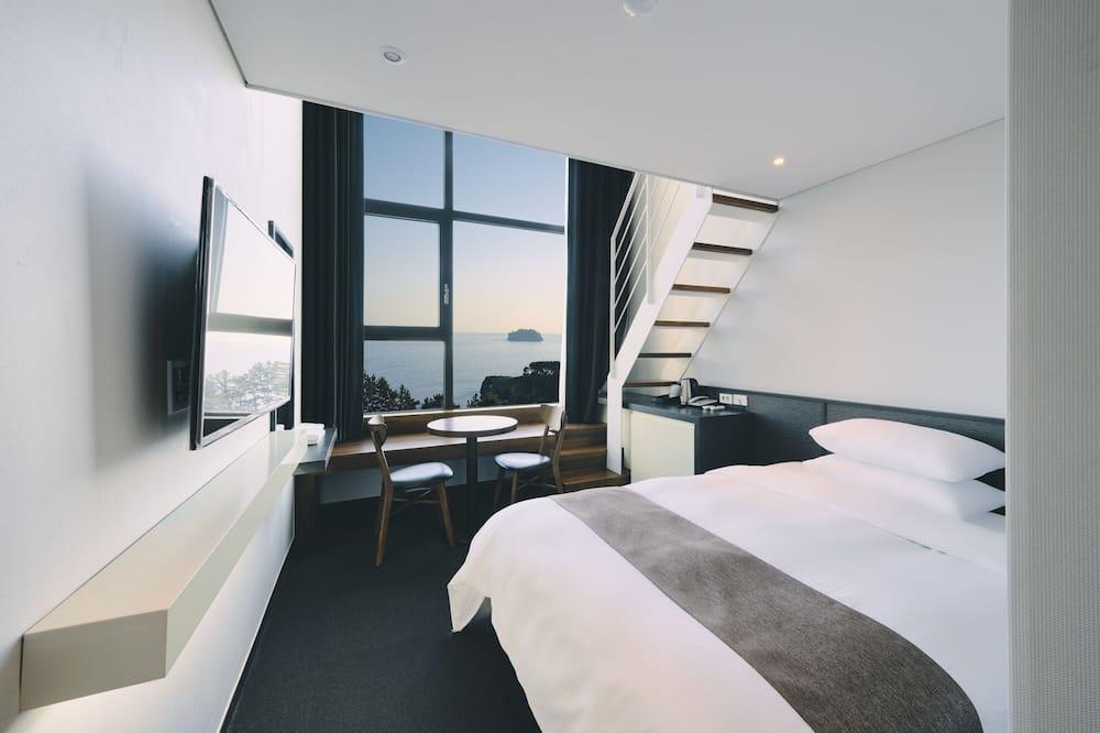 Habitación panorámica, 2 camas de matrimonio, no fumadores, vistas al mar - Imagen destacada