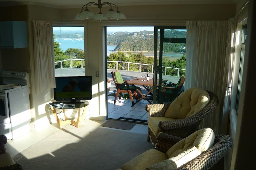 Apartemen Panorama, 1 Tempat Tidur King, pemandangan laut, menghadap laut - Ruang Keluarga