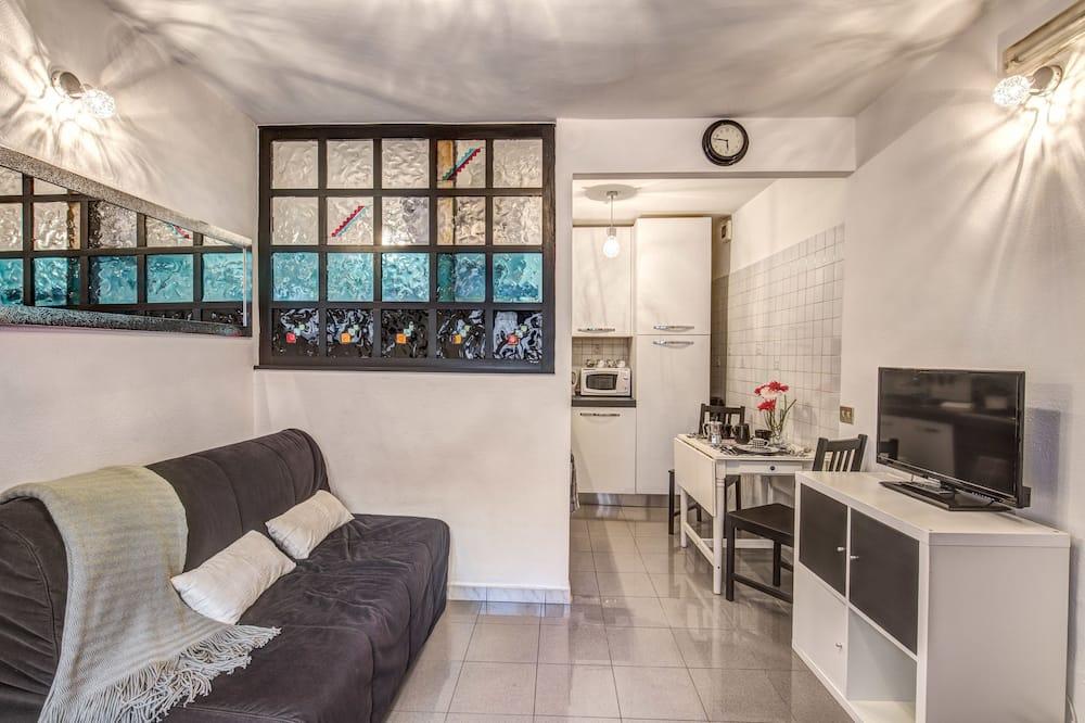 Klassiek appartement, 1 slaapkamer, keuken, op benedenverdieping (Via Cesena 22) - Woonruimte