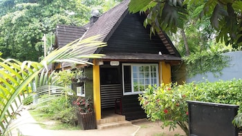 Picture of Firefly Beach Cottages and Suites in Negril