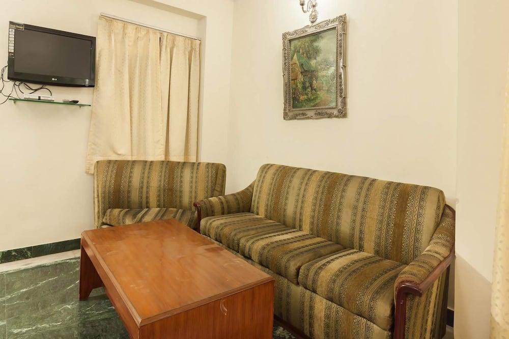 ห้องสแตนดาร์ดดับเบิลหรือทวิน, เตียงใหญ่ 1 เตียง - พื้นที่นั่งเล่น