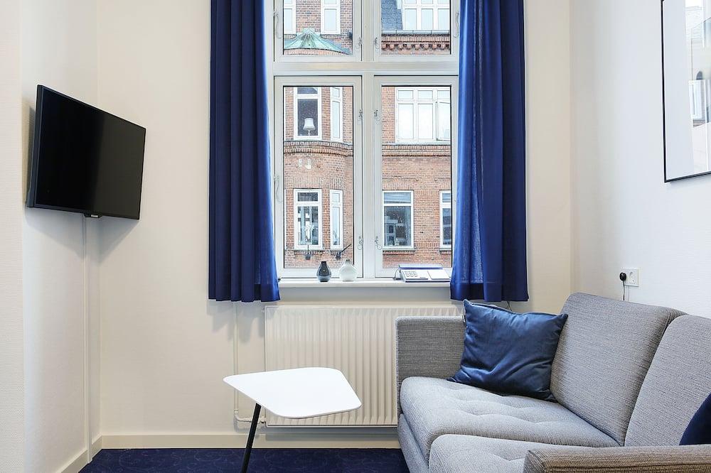 Полулюкс, 1 двуспальная кровать «Кинг-сайз», вид на город - Зона гостиной