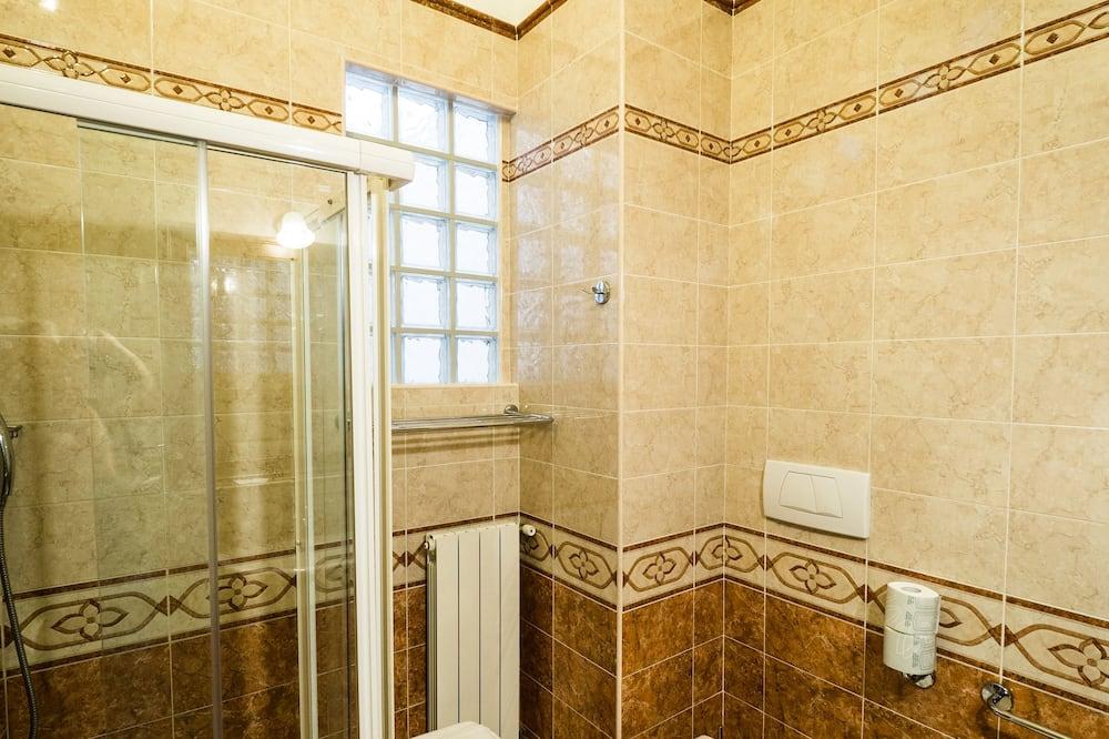 Pokoj Deluxe s dvojlůžkem pro 1 osobu - Koupelna
