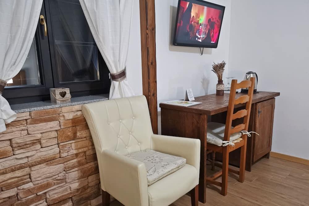 Quarto Familiar, 1 cama king-size com sofá-cama, Vista Jardim - Sala de Estar