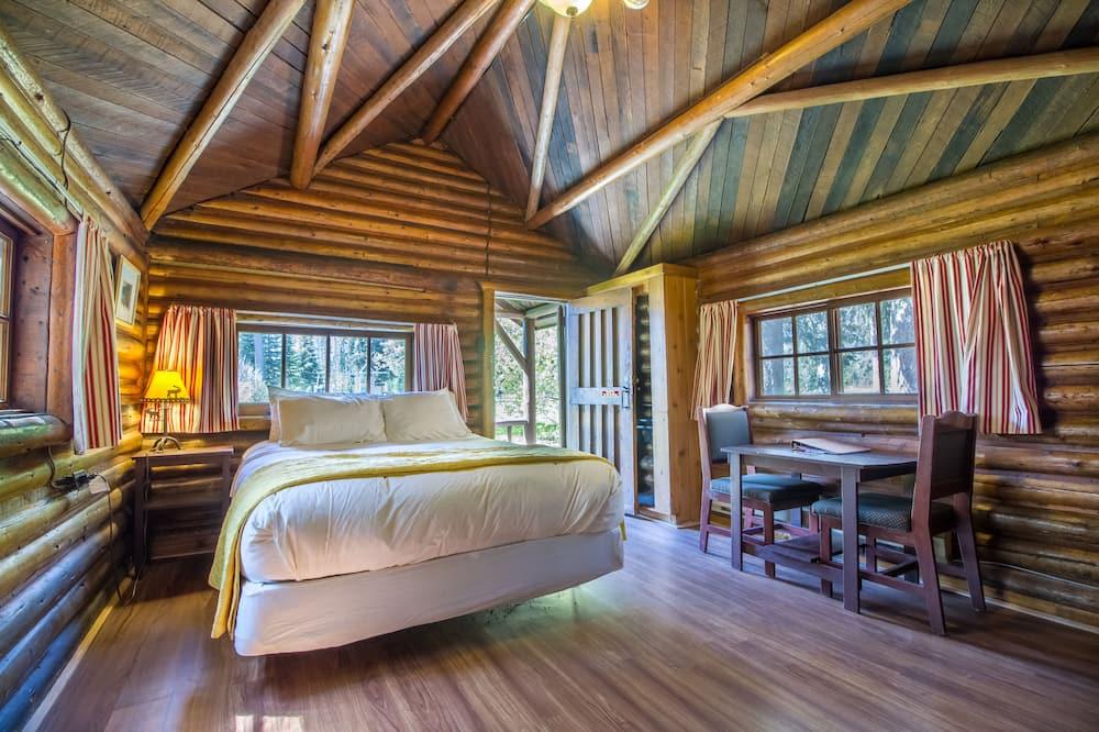 كابينة تقليدية - سرير كبير - بمدفأة - منظر للجبل - الغرفة