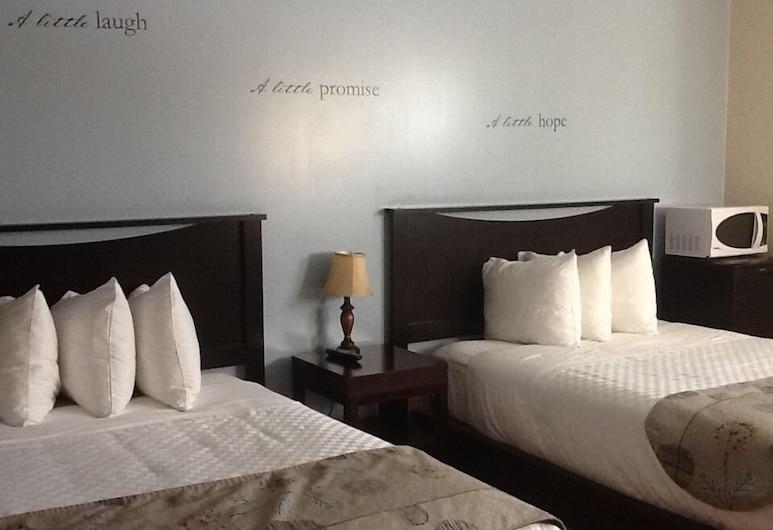 ترافيلرز إن, كينورا, غرفة تقليدية - سريران مزدوجان, غرفة نزلاء