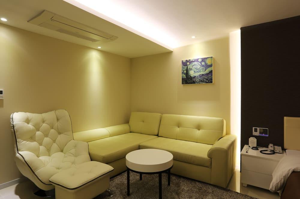 Deluxe kamer (B) - Woonruimte