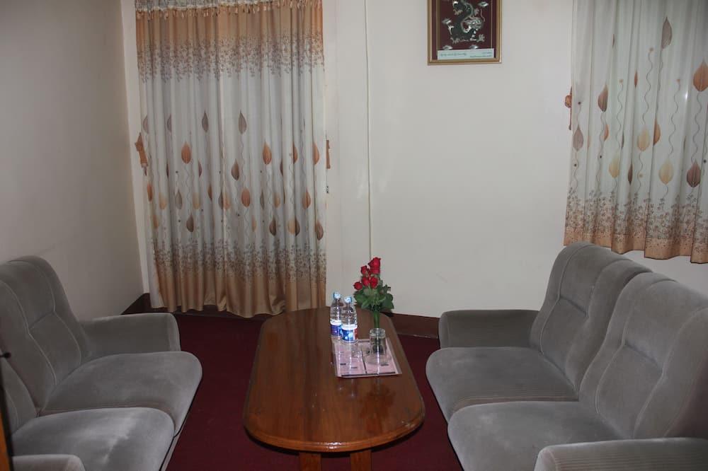 Chambre Double Supérieure - Coin séjour