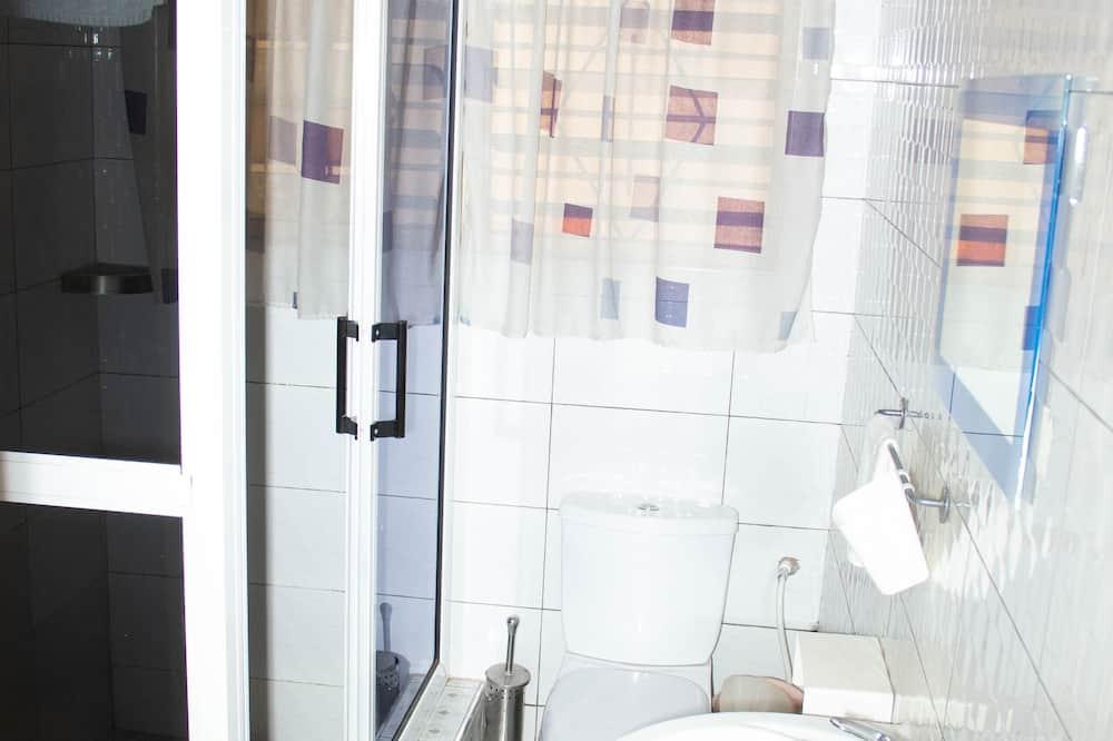 Сімейний двомісний номер (2 односпальних ліжка), 1 спальня - Ванна кімната