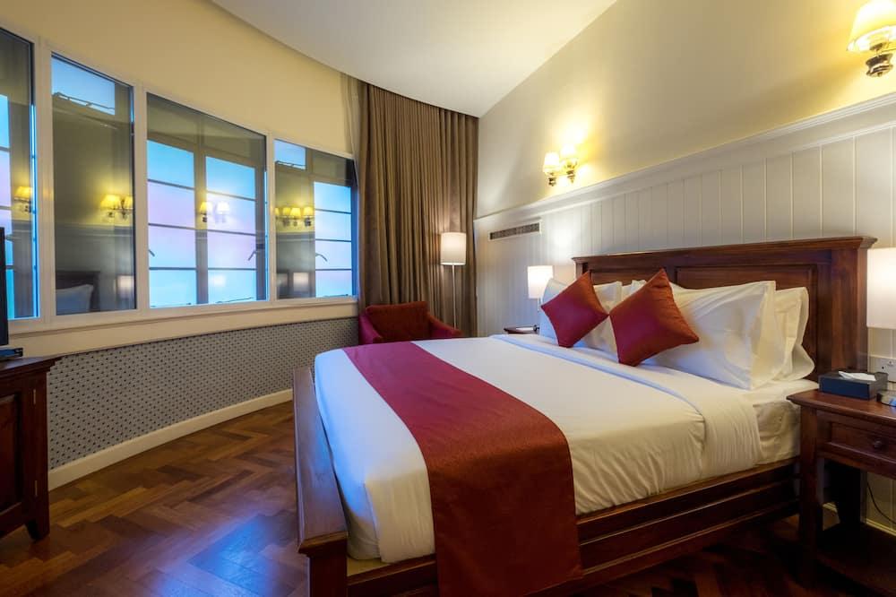Pokoj Deluxe s dvojlůžkem - Obývací pokoj