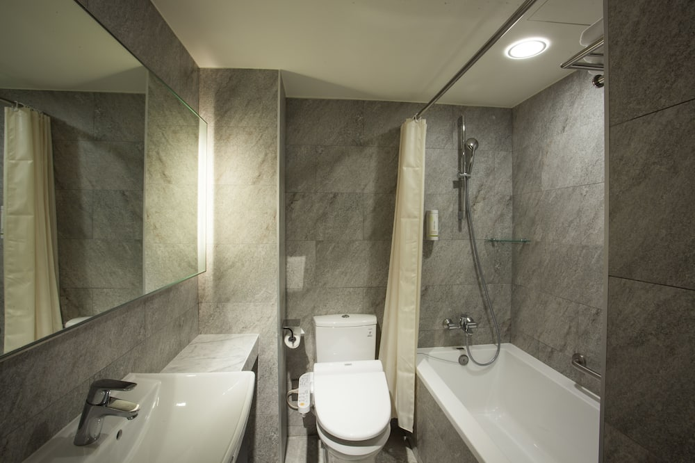Luxe driepersoonskamer - Badkamer