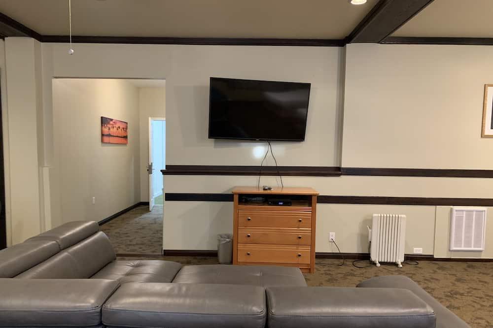Suite monolocale familiare - Area soggiorno