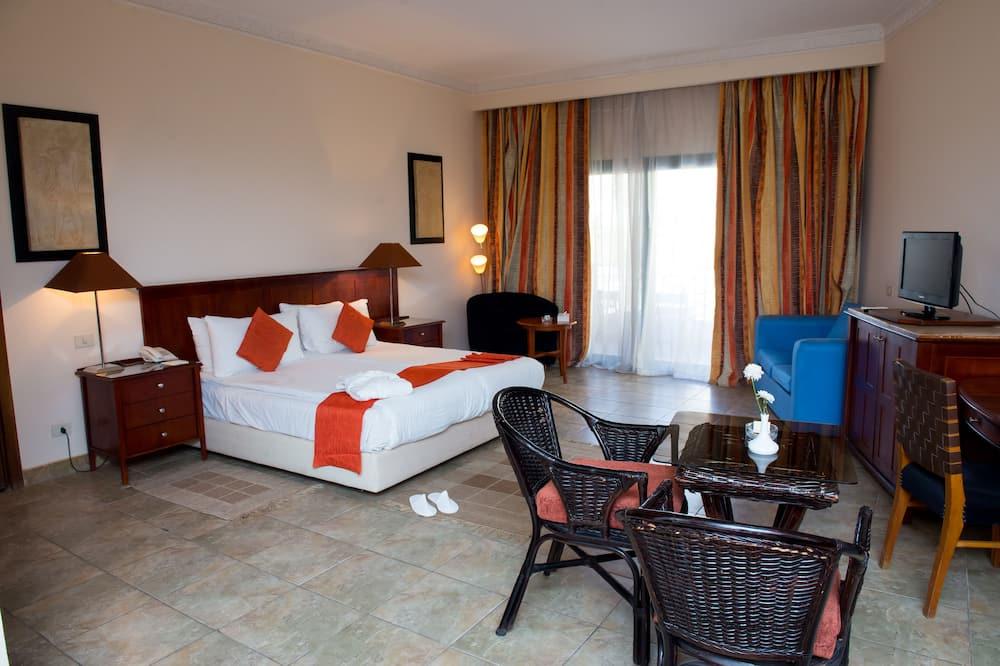 Habitación superior, 1 cama King size, baño privado, vista al campo de golf - Servicio de comidas en la habitación