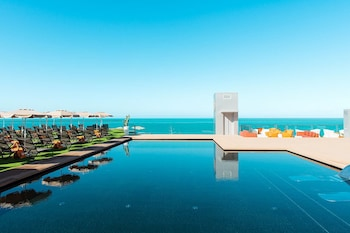 Enter your dates to get the Mogan hotel deal