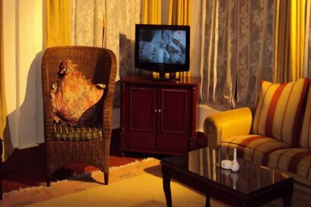Deluxe suite, 1 kingsize bed, Bad, uitzicht op vallei - Woonruimte