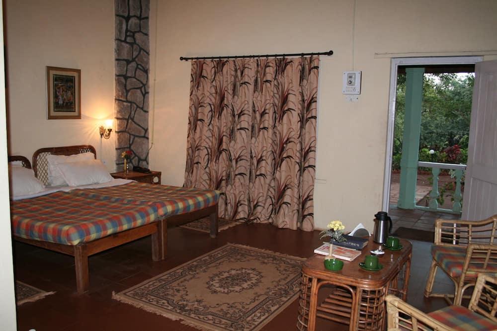 Quarto Duplo Deluxe, 1 cama de casal, Acessível, Vista Rio - Sala de Estar